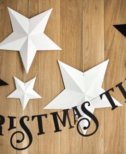 Kerstbanner met witte en zwarte sterren